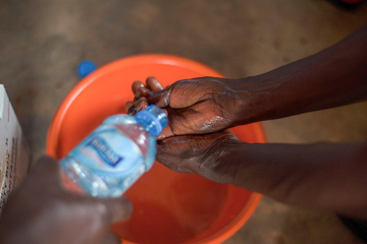Washing hands in a bucket