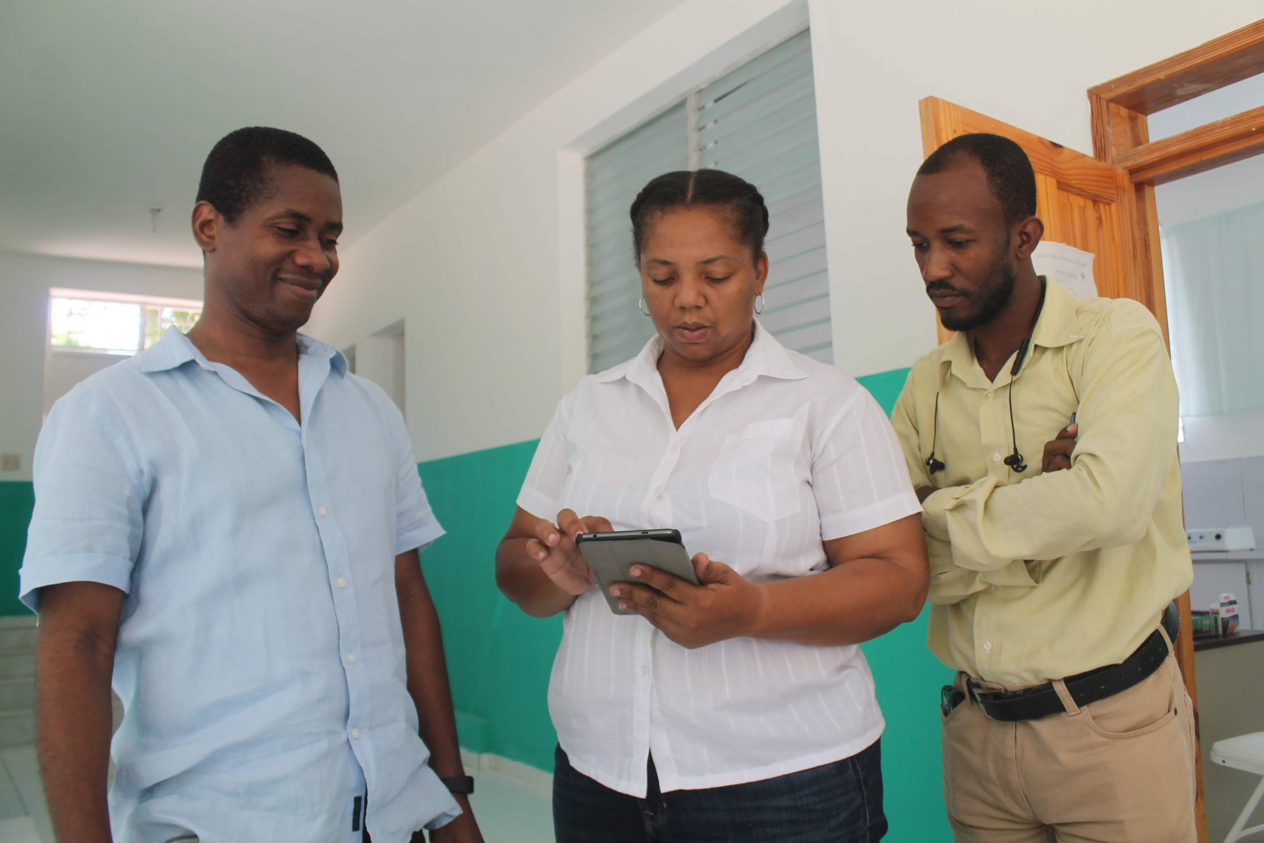 Three doctors with a digital tablet