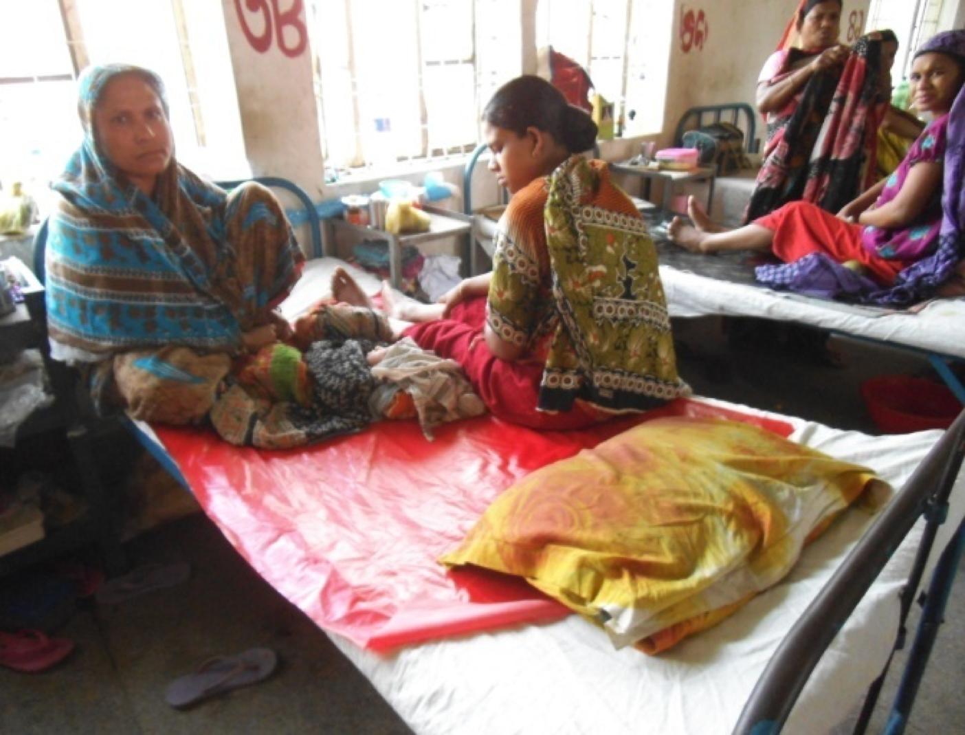 Women in hospital with their newborns