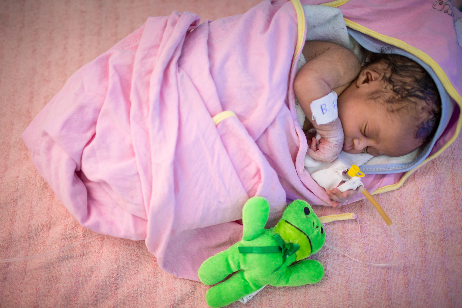 A newborn infant receives specialised care at the UNICEF