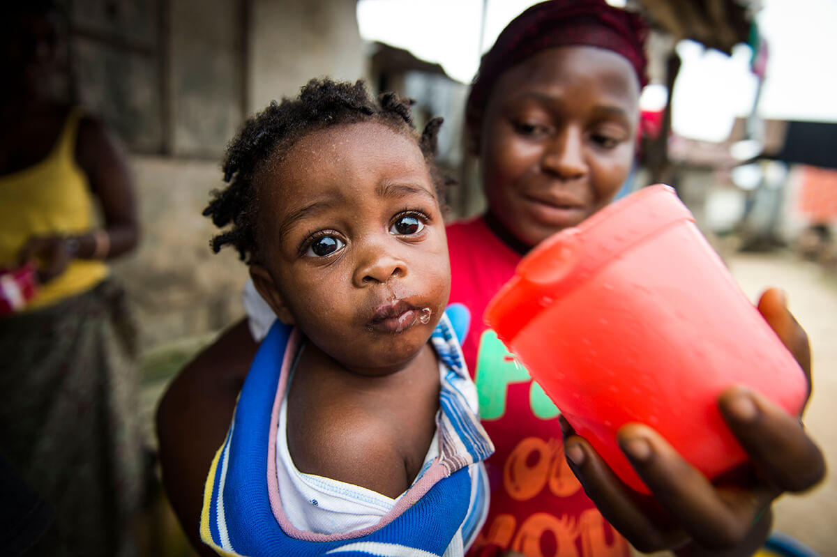 Child drinking water, Water Mission Liberia